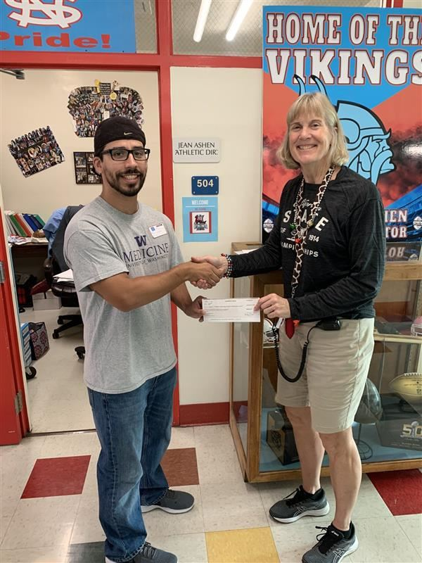 NSHS grad Dr. Magana  pays back scholarship with interest